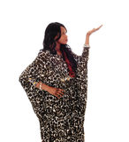 African American woman in dress pointing up. Royalty Free Stock Images