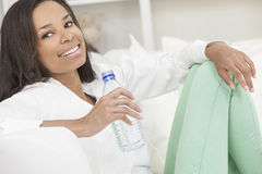 African American Woman Drinking Bottle of Water Royalty Free Stock Photography