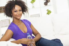African American Woman Drinking Bottle of Water Stock Photography