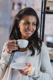 African american woman drinking coffee at home, breakfast. Young african american woman drinking coffee at home, breakfast Royalty Free Stock Photography