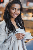 African american woman drinking coffee at home, breakfast. Young african american woman drinking coffee at home, breakfast Royalty Free Stock Photos