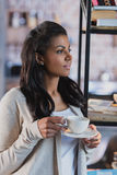 African american woman drinking coffee at home, breakfast Royalty Free Stock Photography