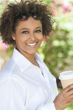 African American Woman Drinking Coffee Outside Royalty Free Stock Photos