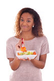 African American woman eating salad, isolated on white backgroun. D Stock Images