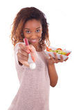 African American woman eating salad, isolated on white backgroun Royalty Free Stock Photo