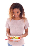 African American woman eating salad, isolated on white backgroun. D Royalty Free Stock Photo