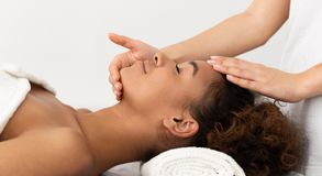 African-American Woman Enjoying Anti Aging Facial Massage stock image