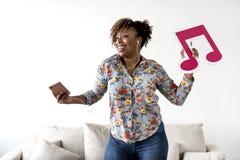 African American woman enjoying music at home stock photos