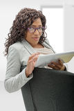 African american woman with eyeglasses and tablet computer Stock Image