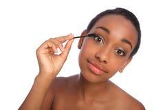 African American woman eyelash separator brush Royalty Free Stock Photos