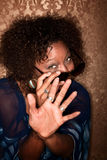 African American Woman fending off a Camera Royalty Free Stock Images