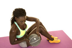 African American woman  fitness green bra sit twist with ball Stock Photos