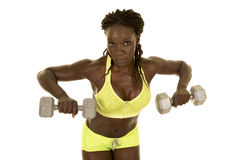 African American woman fitness green outfit lean out with weight Royalty Free Stock Photos