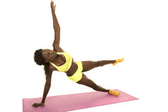 African American woman fitness green outfit side plank stretch u Royalty Free Stock Image