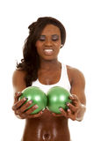 African American woman fitness white bra balls look down Stock Photography