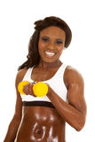 African American woman fitness white bra curl small weight Stock Image