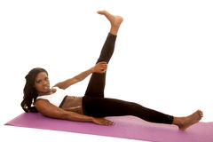 African American woman fitness white bra lay leg up Stock Images