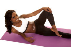 African American woman fitness white bra lay top view Royalty Free Stock Images