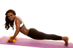 African American woman fitness white bra push up side weights Stock Images