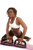 African American woman fitness white bra push up twist looking Royalty Free Stock Photography