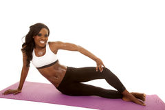 African American woman fitness white bra sit side smile Royalty Free Stock Photos