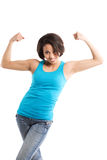 African american woman flexing arms. An isolated shot of an african american woman flexing her arms showing her muscle Royalty Free Stock Images