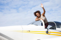 African American woman flying a private plane Stock Images