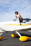 African American woman flying a private plane Stock Photo