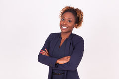 African American woman with folded arms,  on grey backgr Royalty Free Stock Photo