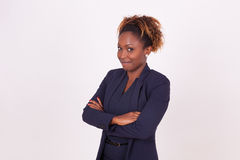 African American woman with folded arms,  on grey backgr Stock Photo