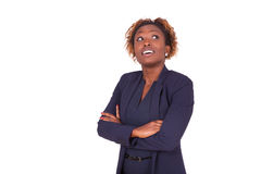 African American woman with folded arms looking up , isolated on Royalty Free Stock Photo
