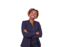 African American woman with folded arms looking up , isolated on Royalty Free Stock Images