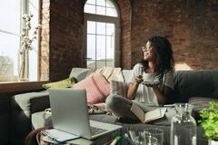 African-american woman, freelancer during the work in home office while quarantine