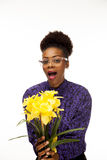 African American woman with fresh flowers. An African American woman is happy with the fresh flowers she was given stock photography