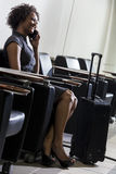 African American Woman Girl On Cell Phone Airport Royalty Free Stock Images