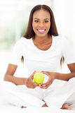 African american woman green apple Royalty Free Stock Photography