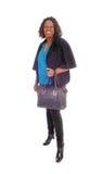 African American woman with handbag. Stock Photo
