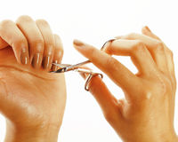 African american woman hands making no qualified manicure, pedicure to herself isolated with tools, bad nails Stock Image