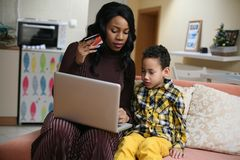 African American woman with her son. Royalty Free Stock Photo