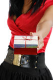 African american woman holding christmas present Royalty Free Stock Photos