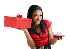African american woman holding christmas present Royalty Free Stock Photo