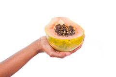 African American woman holding a fresh papaya in her hand Royalty Free Stock Photography