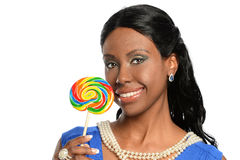 African American Woman Holding Lollypop. Portrait of beautiful African American woman holding lollypop isolated over white background Stock Photo