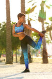 African american woman holding one leg stretching exercise Royalty Free Stock Photo