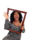 African American woman holding a picture frame. Stock Image