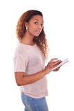 African American Woman holding a tactile tablet Royalty Free Stock Image