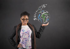 African American woman holding the world success rocket in her hand Stock Image