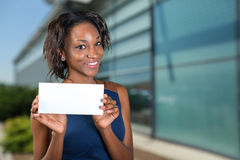 African american woman holds a business card Royalty Free Stock Images
