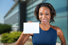 African american woman holds a business card Stock Photography
