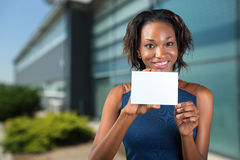 African american woman holds a business card Stock Images